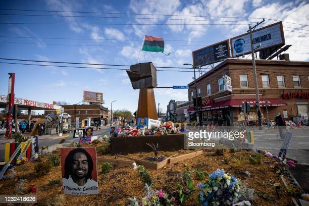 Pan-African flag flies above a wooden fist statue at George Floyd Square in Minneapolis, Minnesota, U.S., on Tuesday, April 20, 2021. The case of the...