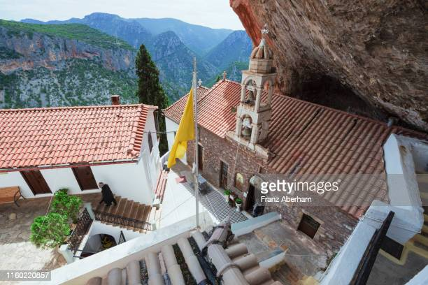 panagia elona monastery, build under a rock face - franz aberham stock photos and pictures
