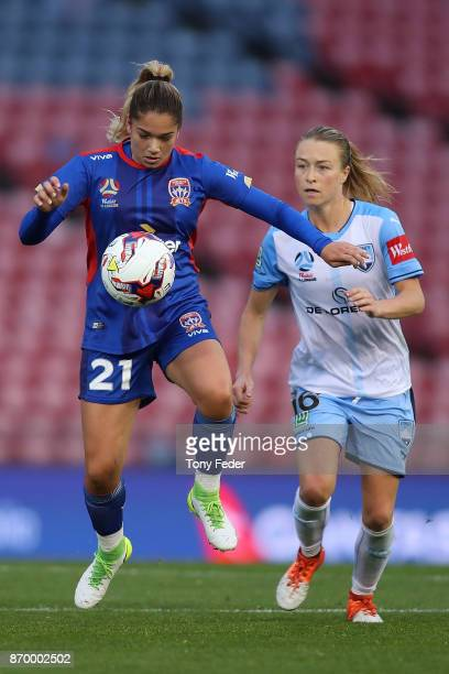 Panagiota Petratos of the Jets contests the ball with Emily Sonnett of Sydney FC during the round two WLeague match between the Newcastle Jets and...