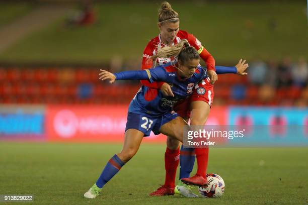 Panagiota Petratos of the Jets contests the ball with Stephanie Catley of City during the round 14 WLeague match between the Newcastle Jets and...