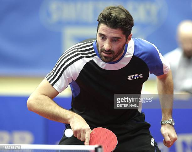 Panagiotis Gionis of Greece plays against Patrick Baum of Germany during the final of the mens team event at the Table Tennis European championship...