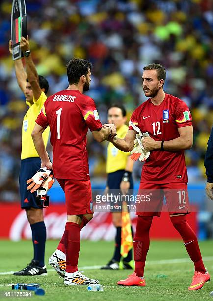 Panagiotis Glykos of Greece enters the game for Orestis Karnezis during the 2014 FIFA World Cup Brazil Group C match between Greece and Cote D'Ivoire...