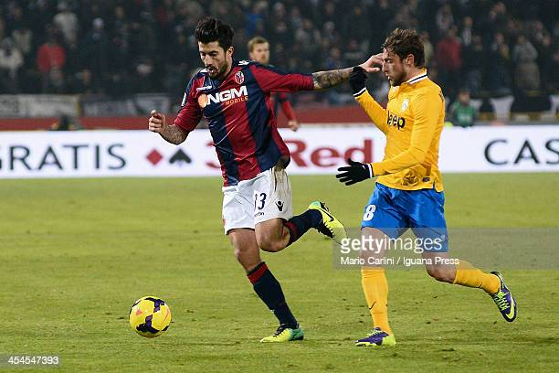 Panagiotis Kone of Bologna FC competes for the ball with Claudio Marchisio of Juventus during the Serie A match between Bologna FC and Juventus at...