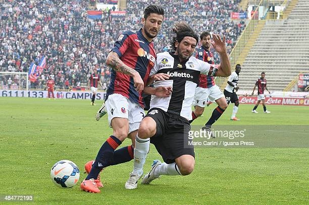 Panagiotis Kone of Bologna FC competes the ball with Alessandro Lucarelli of Parma FC during the Serie A match between Bologna FC and Parma FC at...