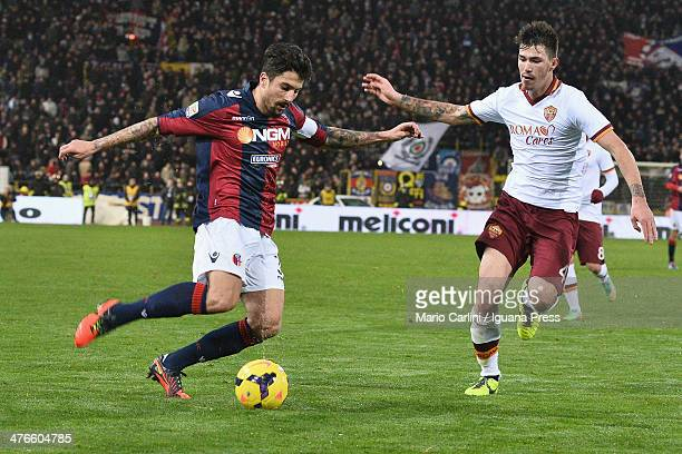 Panagiotis Kone of Bologna FC competes the ball with Alessio Romagnoli of AS Roma during the Serie A match between Bologna FC and AS Roma at Stadio...