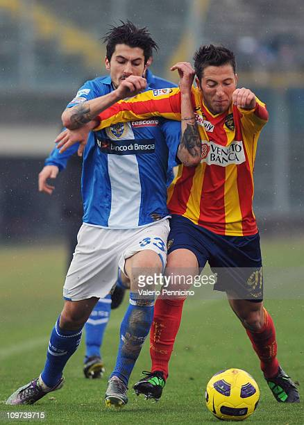 Panagiotis Kone of Brescia Calcio competes for the ball with Andrea Bertolacci of Lecce during the Serie A match between Brescia Calcio and Lecce at...