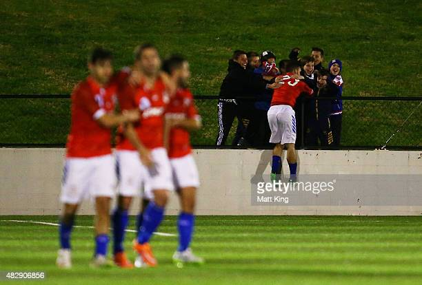 Panagiotis Nikas of Sydney United celebrates with younf fans after scoring their second goal during the FFA Cup match between Sydney United 58 FC and...