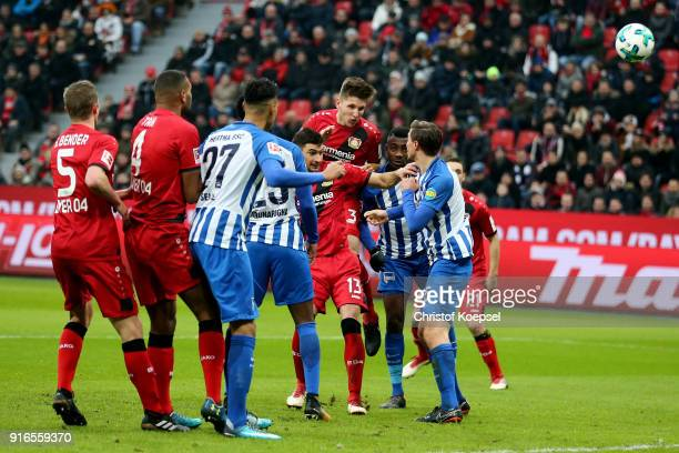 Panagiotis Retsos and Lucas Alario of Leverkusen go up for a header during the Bundesliga match between Bayer 04 Leverkusen and Hertha BSC at...