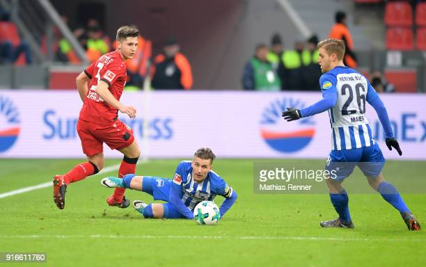 Panagiotis Retsos of Bayer 04 Leverkusen Peter Pekarik and Arne Maier of Hertha BSC during the first Bundeliga game between Bayer 04 Leverkusen and...