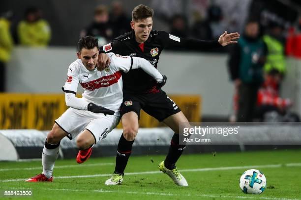 Panagiotis Retsos of Bayer Leverkusen and Anastasios Donis of VfB Stuttgart battle for the ball during the Bundesliga match between VfB Stuttgart and...