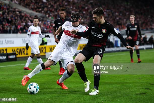 Panagiotis Retsos of Bayer Leverkusen and Emiliano Insua of VfB Stuttgart battle for the ball during the Bundesliga match between VfB Stuttgart and...