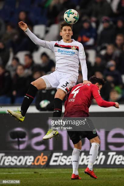 Panagiotis Retsos of Bayer Leverkusen and Julian Korb of Hannover 96 battle for the ball during the Bundesliga match between Hannover 96 and Bayer 04...