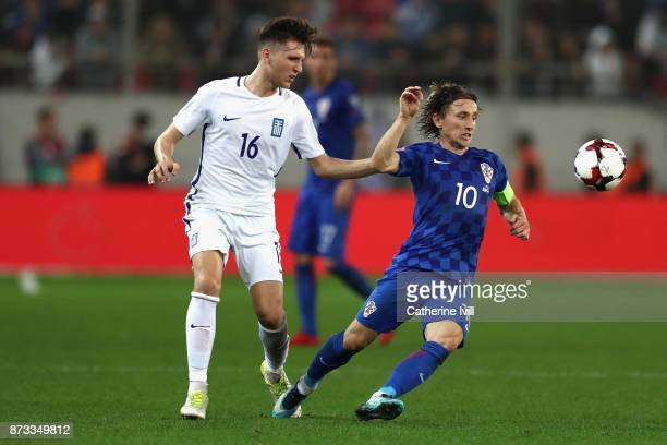 Panagiotis Retsos of Greece and Luka Modric of Croatia in action during the FIFA 2018 World Cup Qualifier PlayOff Second Leg between Greece and...