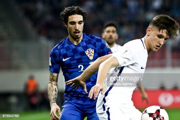 Panagiotis Retsos of Greece in action against Sime Vrsalko of Croatia during the World Cup Russia 2018 European Qualifiers match between Greece and...