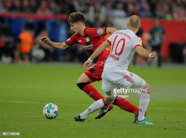 Panagiotis Retsos of Leverkusen and Arjen Robben of Muenchen battle for the ball during the DFB Cup semi final match between Bayer 04 Leverkusen and...