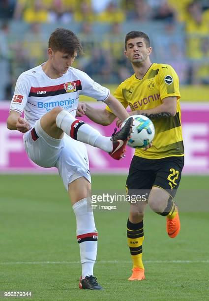 Panagiotis Retsos of Leverkusen and Christian Pulisic of Dortmund battle for the ball during the Bundesliga match between Borussia Dortmund and Bayer...