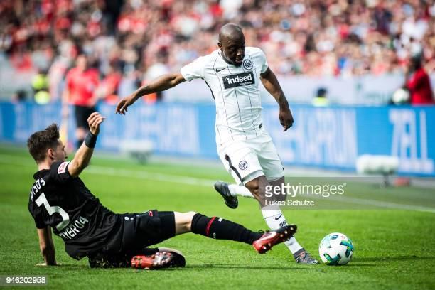Panagiotis Retsos of Leverkusen and Jetro Willems of Frankfurt in action during the Bundesliga match between Bayer 04 Leverkusen and Eintracht...