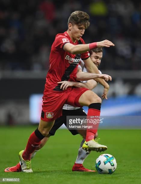 Panagiotis Retsos of Leverkusen and Marc Stendera of Frankfurt compete for the ball during the Bundesliga match between Eintracht Frankfurt and Bayer...