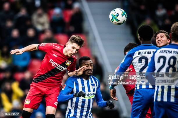 Panagiotis Retsos of Leverkusen and Salomon Kalou head the ball during the Bundesliga match between Bayer 04 Leverkusen and Hertha BSC at BayArena on...