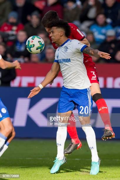 Panagiotis Retsos of Leverkusen and Thilo Kehrer of Schalke battle for the ball during the Bundesliga match between Bayer 04 Leverkusen and FC...