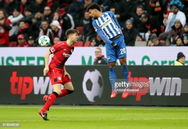 Panagiotis Retsos of Leverkusen and Valentino Lazaro mbe00 go up for a header during the Bundesliga match between Bayer 04 Leverkusen and Hertha BSC...