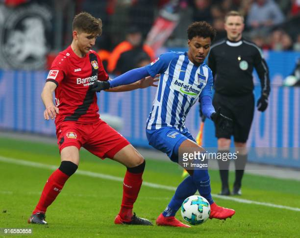 Panagiotis Retsos of Leverkusen and Valentino Lazaro of Hertha battle for the ball during the Bundesliga match between Bayer 04 Leverkusen and Hertha...