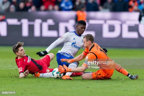 Panagiotis Retsos of Leverkusen Breel Embolo of Schalke and Goalkeeper Bernd Leno of Leverkusen battle for the ball during the Bundesliga match...