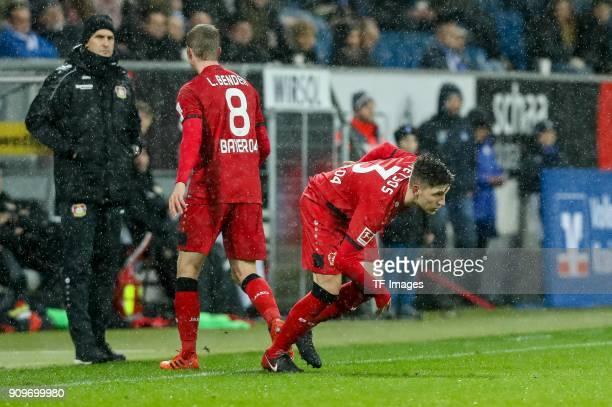 Panagiotis Retsos of Leverkusen comes on as a substitute for Lars Bender of Leverkusen during the Bundesliga match between TSG 1899 Hoffenheim and...