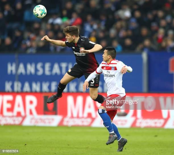 Panagiotis Retsos of Leverkusen fights for the ball with Bobby Wood of Hamburg during the Bundesliga match between Hamburger SV and Bayer 04...