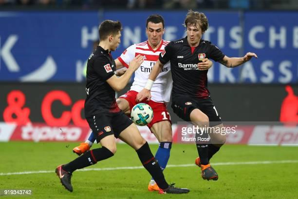 Panagiotis Retsos of Leverkusen Filip Kostic of Hamburg and Tin Jedvaj of Bayer Leverkusen fight for the ball during the Bundesliga match between...