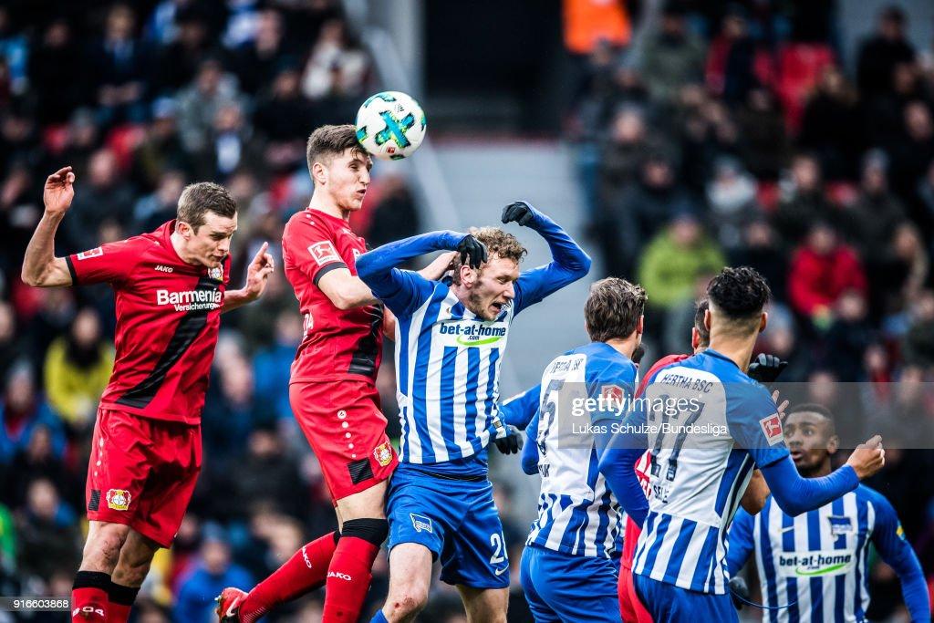 Panagiotis Retsos (2L) of Leverkusen heads the ball during the Bundesliga match between Bayer 04 Leverkusen and Hertha BSC at BayArena on February 10, 2018 in Leverkusen, Germany.
