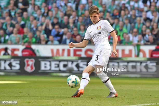 Panagiotis Retsos of Leverkusen kicks the ball during the Bundesliga match between SV Werder Bremen and Bayer 04 Leverkusen at Weserstadion on May 5...