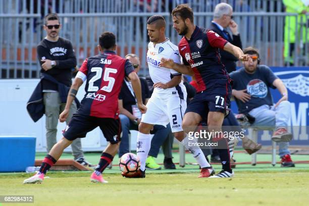 Panagiotis Tachtsidis and Mauricio Isla of Cagliari and Laurini Vincent of Empoli during the Serie A match between Cagliari Calcio and Empoli FC at...