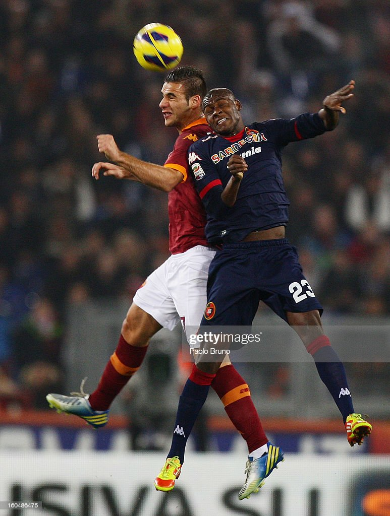 Panagiotis Tachtsidis (L) of AS Roma competes for the ball with Victor Ibarbo of Cagliari Calcio during the Serie A match between AS Roma and Cagliari Calcio at Stadio Olimpico on February 1, 2013 in Rome, Italy.
