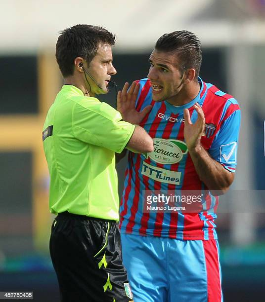 Panagiotis Tachtsidis of Catania and referee Nicola Rizzoli react during the Serie A match between Calcio Catania and AC Milan at Stadio Angelo...