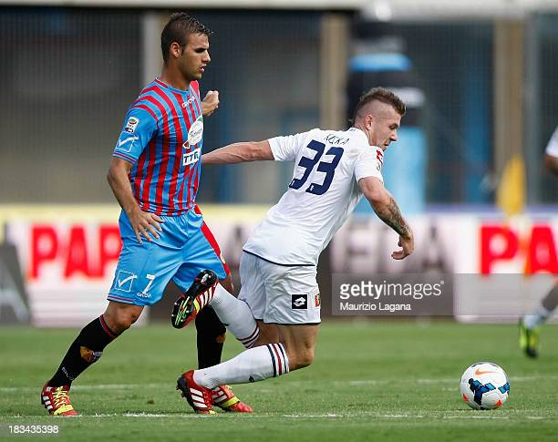 Panagiotis Tachtsidis of Catania competes for the ball with Juraj Kucka of Genoa during the Serie A match between Calcio Catania and Genoa CFC at...