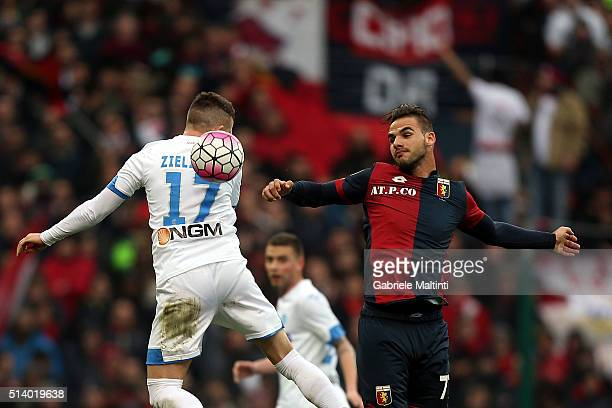 Panagiotis Tachtsidis of Genoa CFC battles for the ball with Piotr Zielinski of Empoli FC during the Serie A match between Genoa CFC and Empoli FC at...