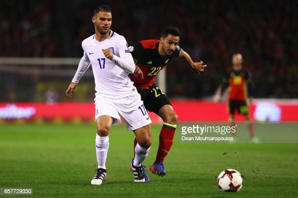 Panagiotis Tachtsidis of Greece battles for the ball with Nacer Chadli of Belgium during the FIFA 2018 World Cup Group H Qualifier match between...