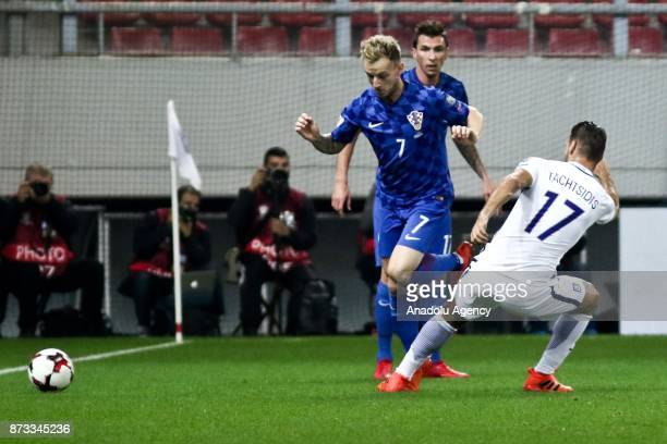 Panagiotis Tachtsidis of Greece in action against Ivan Rakitic of Croatia during the World Cup Russia 2018 European Qualifiers match between Greece...
