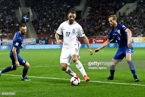 Panagiotis Tachtsidis of Greece in action against Ivan Strinic of Croatia during the World Cup Russia 2018 European Qualifiers match between Greece...