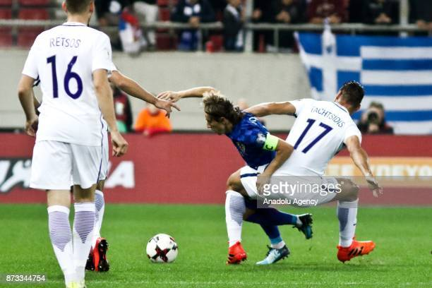 Panagiotis Tachtsidis of Greece in action against Luca Modric of Croatia during the World Cup Russia 2018 European Qualifiers match between Greece...
