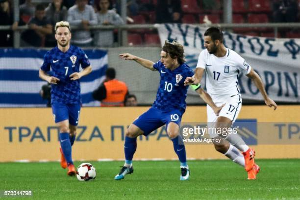 Panagiotis Tachtsidis of Greece in action against Luka Modric of Croatia during the World Cup Russia 2018 European Qualifiers match between Greece...
