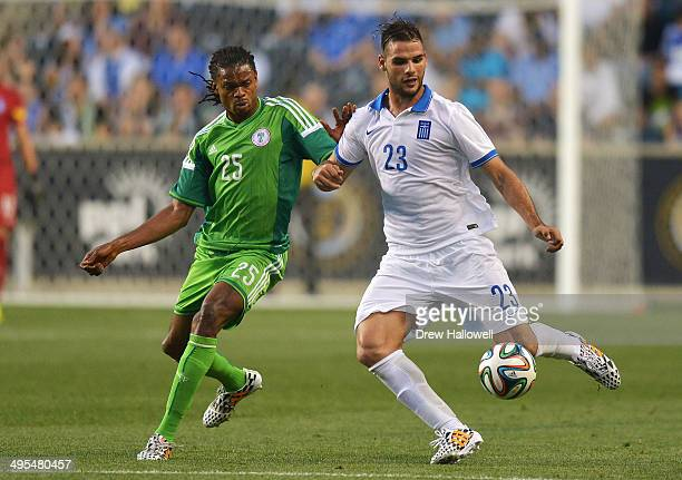 Panagiotis Tachtsidis of Greece kicks the ball away from Michael Uchebo of Nigeria during an international friendly match at PPL Park on June 3 2014...