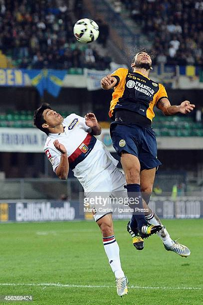 Panagiotis Tachtsidis of Hellas Verona FC competes the ball with Facundo Roncaglia of Genoa CFC during the Serie A match between Hellas Verona FC and...
