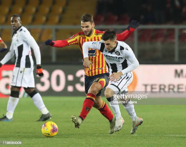 Panagiotis Tachtsidis of Lecce competes for the ball with Ignacio Pussetto of Udinese during the Serie A match between US Lecce and Udinese Calcio at...