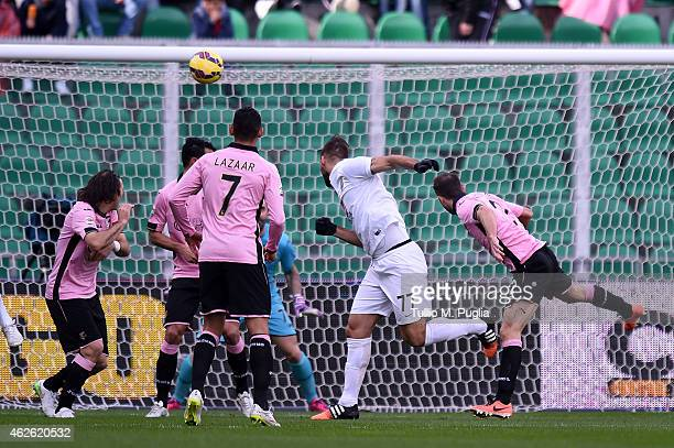 Panagiotis Tachtsidis scores the opening goal during the Serie A match between US Citta di Palermo and Hellas Verona FC at Stadio Renzo Barbera on...