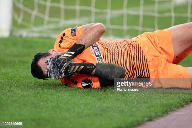 Panagiotis Tsintotas of AEK Athens holds his face in pain during the UEFA Europa League Group G stage match between AEK Athens and Leicester City at...