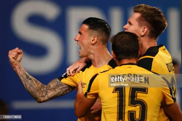 Panagiotis Vlachodimos of Dynamo Dresden celebrates after scoring their side's second goal during the Second Bundesliga match between FC Hansa...
