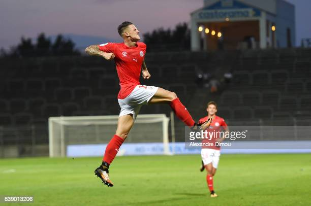 Panagiotis Vlachodimos of Nimes celebrates scoring during the Ligue 2 match between Nimes and Le Havre AC at Stade des Costieres on August 25 2017 in...