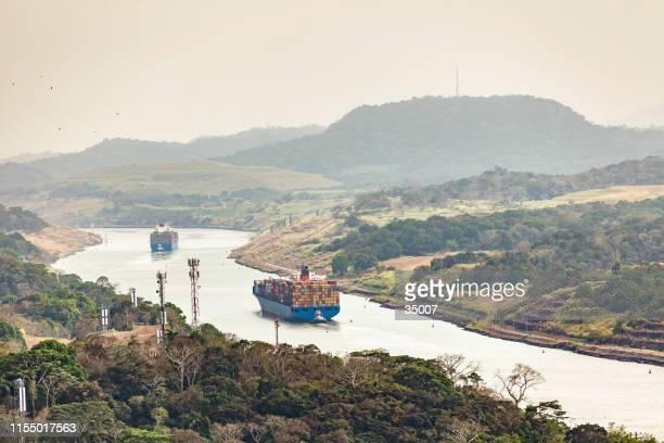 panama canal with huge cargo ships, panama, latin america - panama city panama stock pictures, royalty-free photos & images